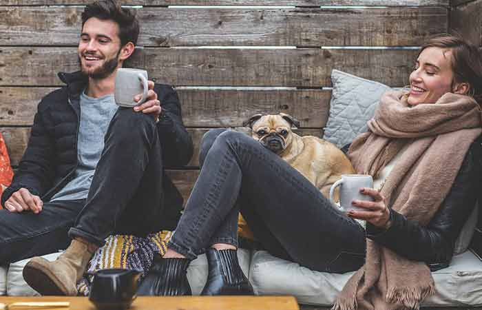 Pet owners enjoying a cup of coffee